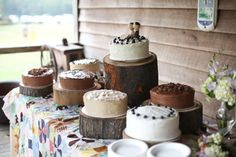 non-traditional assortment of wedding cakes in different flavors from chocolate to vanilla on tree stump cake stands for a rustic wedding Tree Stump Cake, Unique Cake Toppers, Just Serve, Desert Table, Wedding Planning Guide, Cake Table, Beautiful Cakes, Chocolate Cake, Wedding Reception