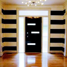 mirror shined floors black and white striped walls PLUS the custom door and and sparkly atomic light fixture = bliss. Mid Century Modern Door, Mid Century House, Mid Century Design, Striped Walls, White Walls, Striped Hallway, Windows And Doors, Front Doors, Small Spaces
