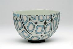 The artwork on this pot accents the bowl really when. The squares in the paint counter round shape