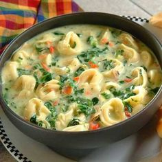 3T olive Oil 1 Clv garlic minced 3 stalks celery chopped 3 carrots, peeled & chopped 1 onion diced 10 oz box fzn spinach (unthawed) 2 cans crm chix soup 2 cans water 32 oz chix broth Family size pckg cheese or chicken tortellini, half cooked  Put olive oil in bottom of large stock pot Saute garlic, celery, carrots & onions til tender  Add fzn spinach. Break up blocks of s pinach  Continue to saute til spinach thaws Add crm of chix soup & water Add chix broth & tortellini Heat & Serve