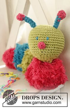 "Crochet DROPS caterpillar with pompoms in ""Cotton Light"". ~ DROPS Design"