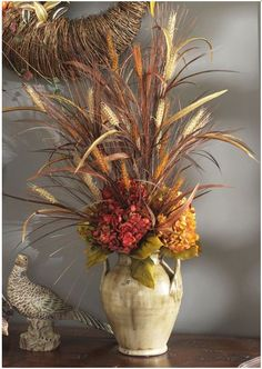 perfectlyfestive | Arrangements | Cornucopia  You can make this.  Our rustic urn creates a spacious showcase for decorative objects.  For this wonderful arrangement, use 6 Hydrangea stems; 2 wheat sprays and one urn.