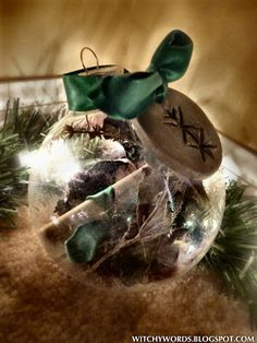 Prosperity Ornament.  Clear glass ornament. Herbs in orb can be a blend of anything you choose that represent prosperity. Basil great for money issues, cinnamon as protection from harm, bay for psychic enhancement, thyme for friendships.