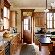 pressed tim ceiling + cabinets with crown moldings