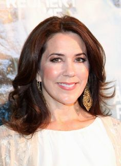Crown Princess Mary topped off her outfit with her trademark hair style - soft waves framing her face - and natural-toned make up.