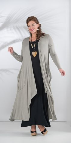 Very stylish outfit for women with some extra kilo's on their hips - join clothes long knitted cardigan and dress