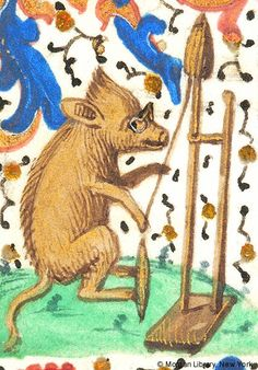 Boar in left margin, wearing spectacles, seated before distaff on stand, holding cord to spindle with right front foot | Book of Hours | Belgium, possibly Brussels | ca. 1475 | The Morgan Library & Musuem