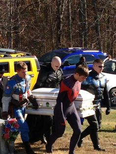 These superheroes visited the little boy while he was fighting cancer, never showing their faces. After he died, they acted as his Pallbearers, taking off their masks in respect.