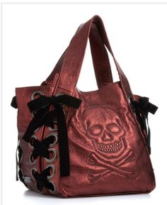 Betsey Johnson purse... ribbon and skull. I want this!!