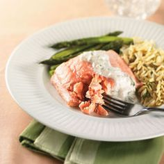 Poached Salmon = 165 calories! This fish dish is flavored with dry white wine, peppercorns and dill.