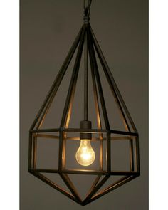 This geometric pendant light has us hooked! Get it here: http://www.bhg.com/shop/noir-diamond-1-light-foyer-pendant-p52457bcbe4b06f9c2d320a04.html