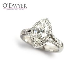 18ct white gold ring with an Marquise cut diamond in the centre surrounded by smaller brilliant cut diamonds. www.odwyer.se