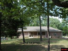 """3 BR 2 BA """"ALL"""" brick with car garage on 2.11 acres m/l just 5 minutes from Bull Shoals Lake. 2908 sq ft home features open concept, fireplace, mother-in-law quarters, whole house generator. Above ground pool w/handicap access, shower & chair lift also handicap ready. 18 X 20 carport perfect for boat in Lakeview AR"""