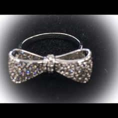 NEW** Crystal Bow Ring Gorgeous bright crystals embedded in this now.  Silvertone ring.  Very eye catching Be Seen Sales Jewelry Rings