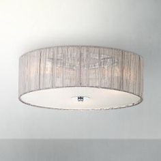 An innovative drum-shape flushmount ceiling light in silver fabric and frosted white glass. wide x 6 high. Canopy is 4 wide. Takes three maximum 40 watt standard base bulbs (not included). Style # 96365 at Lamps Plus. Drum Light Fixture, Ceiling Light Fixtures, Bathroom Ceiling Light, Flush Ceiling Lights, Bedroom Ceiling, Ceiling Lighting, Bedroom Decor, Fabric Ceiling, Nursery Lighting