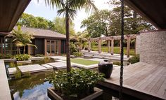 The park-like setting and the material palette create a peaceful ambience which has a distinctive oriental influence. Energy Efficient Homes, Construction Process, Auckland, Cladding, Architecture Design, Eco Friendly, Patio, Mansions