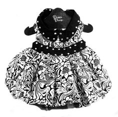 This Floral Dog Dress is great year round for parties. Features studded accents on waist and collar. Tulle lining under skirt makes a fuller and fashionable look. Comes with a Re-enforced D-Ring and heavy duty hook and loop closures. Made with Cotton/Poly Blend Fabric.