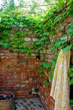 outdoor shower with rubble brickwork and ivy