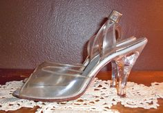 Vintage Princess 1950s Womens Clear Lucite Shoes embellished with a large Rhinestone on each Heel. $35.00, via Etsy.
