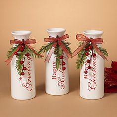 This Gerson International in. Holiday Milk Container Vase - Set of 3 adds country style to your holiday décor. These charming vintage-inspired milk vases are made from white dolomite and painted with red holiday greetings. Christmas Vases, Christmas Crafts For Adults, Christmas Wine Bottles, Farmhouse Christmas Decor, Christmas Projects, Holiday Crafts, Christmas Diy, White Christmas, Diy Crafts For Adults