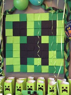 Minecraft creeper made out of 3 different color napkins