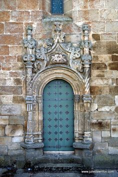 Manueline doorway to the parish church in Freixo de Espada à Cinta, A Surprisingly Manueline Town in the International Douro Natural Park in Portugal. Click to read more on Julie Dawn Fox in Portugal