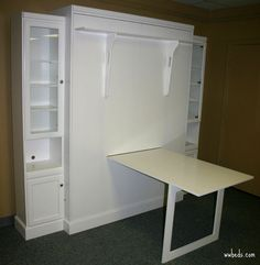 Murphy bed with a desk - by Chris Davis @ LumberJocks.com ~  woodworking community (shelf acts as the legs for the bed)