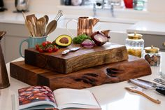 The Live Edge Collection Large Pyman Chopping board is made from Indian acacia wood creating charm and character, this range helps you to bring a feel of the outdoors in by creating a minimal and earthy look. The simplicity of these designs are what makes them so impressive, this chopping board is a chunky slab of wood at 8cm thick creating a natural look. The live edge feature brings an eye catching design to these pieces and highlights the handmade beauty and authenticity of these… Interior S, Decor Interior Design, Kitchen Interior, Interior Decorating, Wooden Chopping Boards, Wholesale Home Decor, Wholesale Furniture, Live Edge Furniture