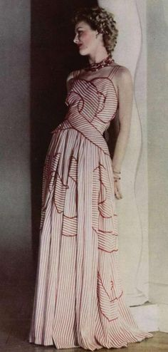 Paris Evening Dress – 1946 [ not made from Rayon of course ! ] Many women of a sewing disposition would attempt to copy these with patterns,