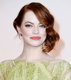 Emma Stone's coral lip and retro side-swept curls at the 87th Oscars