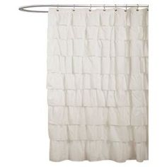 """Ivory ruffled shower curtain. Product: Shower curtainConstruction Material: 100% PolyesterColor: IvoryFeatures: Overlapping rufflesDimensions: 72"""" H x 72"""" WCleaning and Care: Machine washable"""
