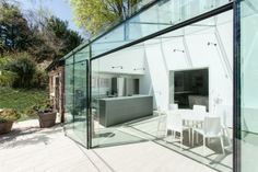 Spectacular Glass House Extension and Interior Redesign with Glass and White Paint Color