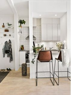 stylish kitchen diner | clever use of small space | bar stools | light and bright interiors | leather