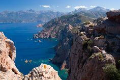 Hiking the Calanche cliffs in Corsica is a must! From there, you'll see huge red rocks falling into the cristal blue water.