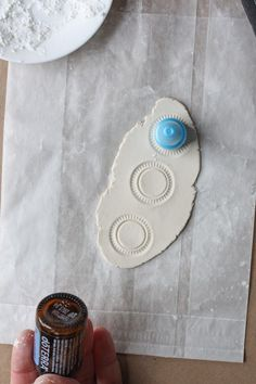 stamp clay with found objects
