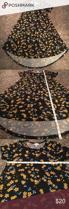 LuLaRoe floral high low dress Gently worn, excellent condition, no flaws, smoke free. 🛍Open to reasonable offers ONLY please! I will not consider unreasonable offers that are half the asking price. No trades. No Modeling. And please keep in mind Poshmark sets the $6.49 flat rate shipping. Thank you!☺ LuLaRoe Dresses High Low