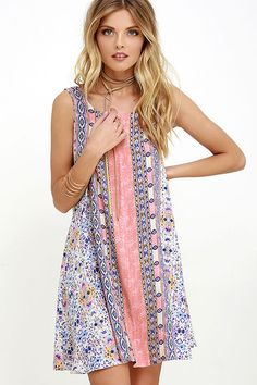 The Whisk Me Away Coral Pink Print Swing Dress is sure to sweep you off your feet! Coral pink, purple, orange, and blue creates a kaleidoscopic print across lightweight woven rayon. Rounded neckline falls into a sleeveless, swing silhouette.