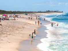 Florida's Atlantic beaches are tan, not white, the sand is more coarse and the waves a bit rougher — in other words, real ocean beaches.