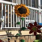 A giant recycled sunflower to set your garden's standards high!    www.reinspirationstore.com
