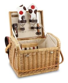 A picnic basket and table in one, the Kabrio has a flat, wooden cover that's ideal for resting glasses or serving fruit and cheese. With wine service for two, double handles and a classic willow desig