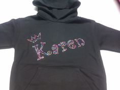 Karen hoodie, written in the funky Curlz font with a cute,little crown. All done in multi coloured bling to contrast against the black hoodie. We can make any name in any of our five fonts, in any colour and this can be put onto a huge variety of garments. If you would like more info, please visit our website or give us a call!