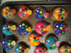 Fishy Cupcakes made with Starbursts for lips and tails and M&Ms for scales. Starburst were difficult to use and were really slimey after being stored. If any other suggestions, let me know. Enjoy!
