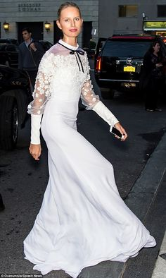 Here's some amazing wedding style inspiration: Karolina Kurkova opted for a modest yet still stunning white gown with sheer floral details for the amfAR Inspiration gala http://dailym.ai/1n6b20j