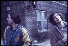 Doug and friend outside a brick building, 1972