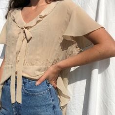 Sand sheer blouse with tulip sleeve and tie detail
