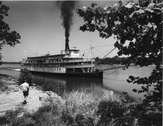 "Riverboats were once a common figure along the Tennessee River.  Large paddle-wheelers such as, the ""Delta Queen"", traveled up and down the Tennessee River transporting passengers and housing social events (taken at Pickwick Reservoir, circa 1945)."