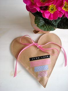 Inspiration: stitched kraft paper heart. Could sew in Christmas shapes: bell, stocking, star, tree...
