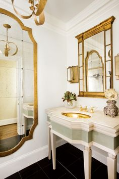Powder room, mirrors, sink console, gold