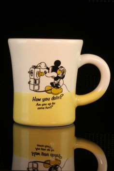 "Disney Mickey Mouse 2 Tone Mug. Mickey says,""How you doin? Are you up for some fun?"" Ceramic mug is 3 1/2 inches tall and 3 inches wide at mouth."