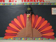 "Thanksgiving bulletin board. Each feather has a sentence, ""I am thankful for ______."" Child writes in word (or tries with help), discussion follows of course.:"